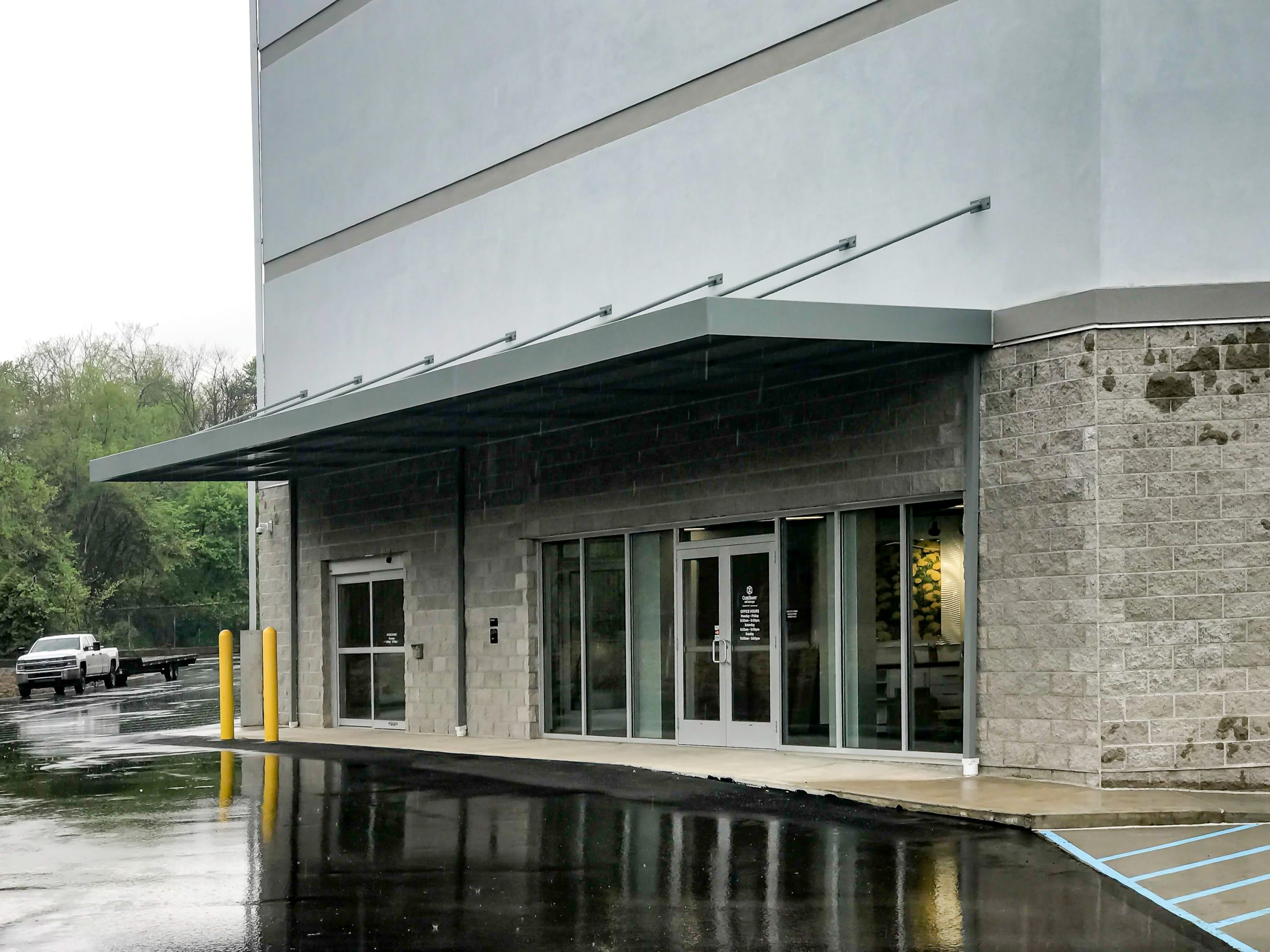 Awnex Featured Project - Hanger Rod Gutter Architectural Canopies - CubeSmart - Pittsburgh, Pennsylvania.