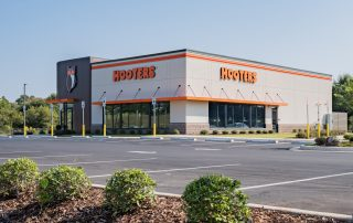 Awnex featured project, orange hanger rod canopies, Hooters - Prattville, Alabama.