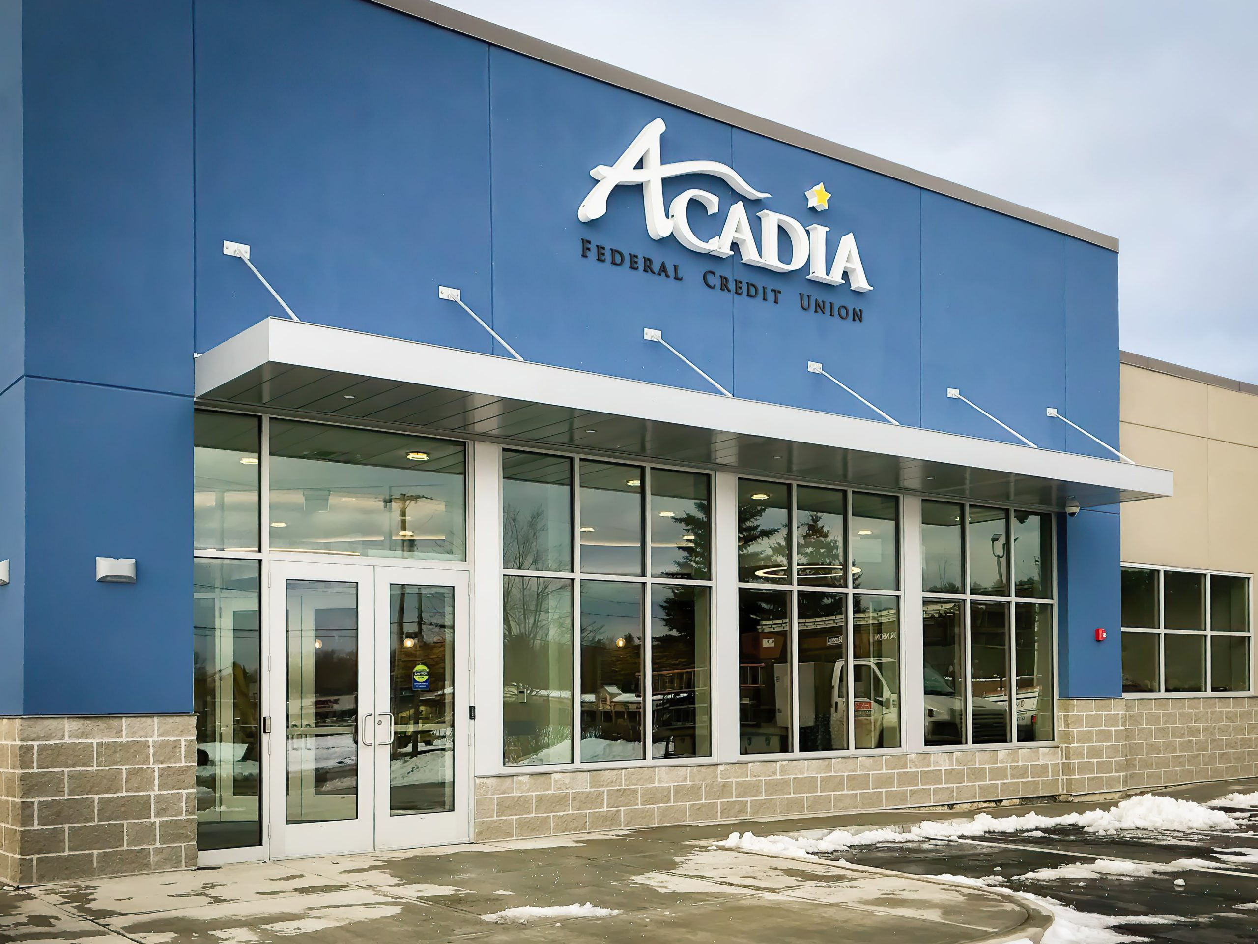 Awnex silver hanger rod canopy project for Acadia Federal Credit Union in Bangor, Maine.